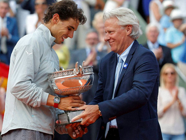 Spain's Rafael Nadal, left, gets the cup from Swedish tennis legend