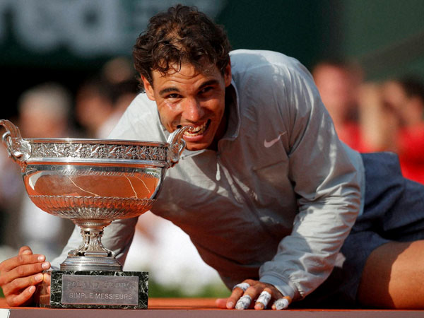 Spain's Rafael Nadal bites the trophy