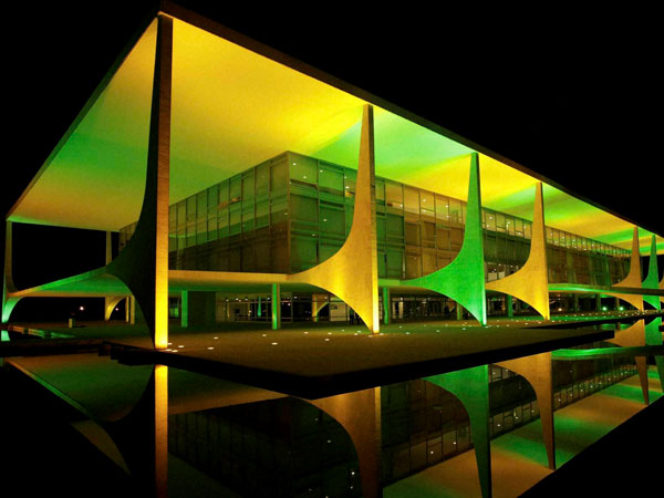 The Planalto presidential palace is illuminated in Brazil's national color