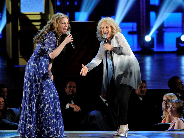 Carole King, right, singing with the cast of the show