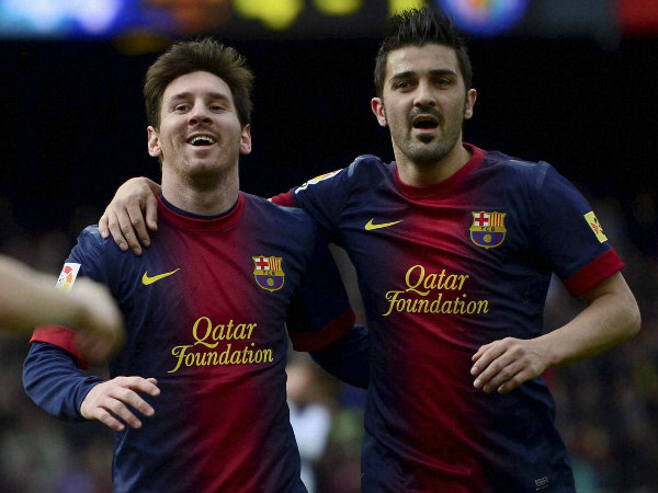 File photo: David Villa (right) with Lionel Messi
