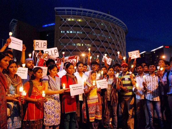 IT professionals & students take part in a candle light march