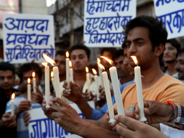 Students take part in candle light protest