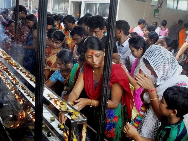 Devotees light incense sticks and earthen lamps at Kamakhya Temple