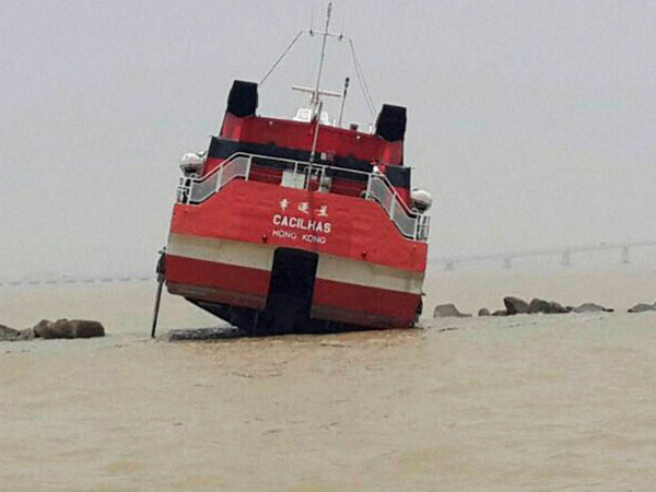 A high-speed ferry heading to Macau crashes into a breakwater