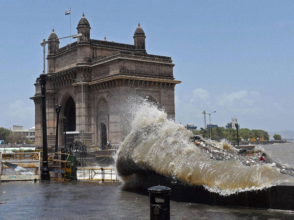 A high tide hits the shore near Gateway of India
