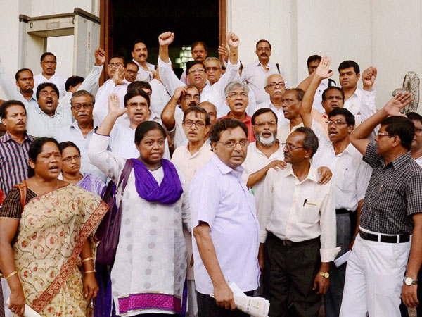 Opposition CPI(M) and other Left party MLAs shout slogans