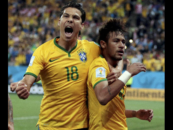 Brazil's Hernanes celebrates with Neymar, right, after the latter scored his second goal on a penalty kick