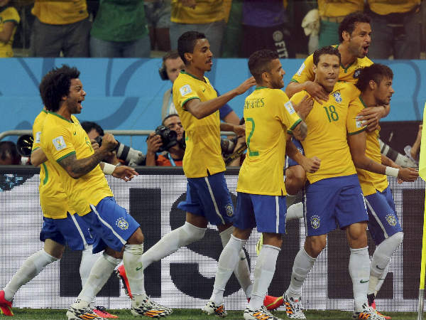 Neymar (right) celebrates wtih teammates after scoring from the spot