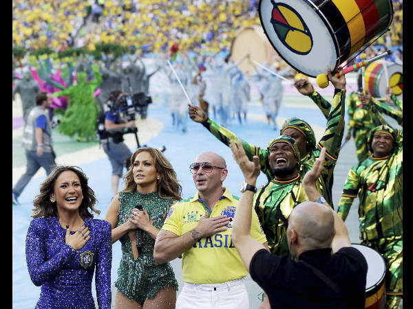 From left: Brazilian singer Claudia Leitte, US singer Jennifer Lopez and rapper Pitbull performing during the opening ceremony