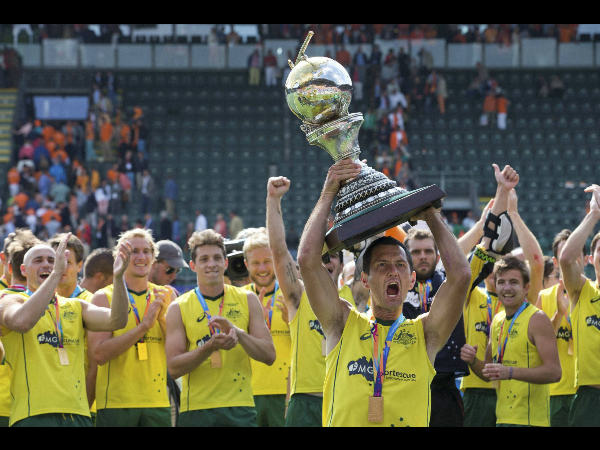 Australia's Jamie Dwyer, holding the trophy, celebrates with his teammates after winning the men's final of the Field Hockey World Cup