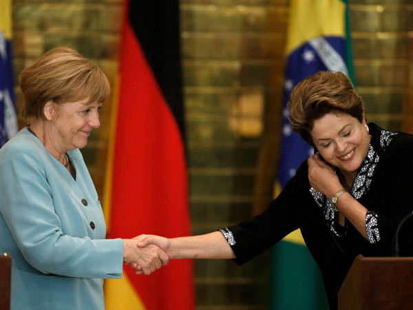 Friendly handshake between Germany and Brazil