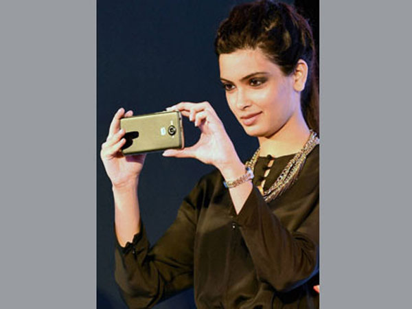 Diana Penty clicking pictures from the Micromax Canvas