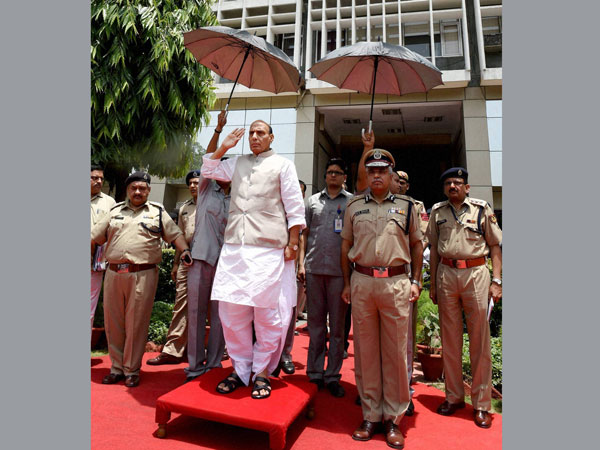 Union Home Rajnath Singh takes the salute before inspecting a guard of honour