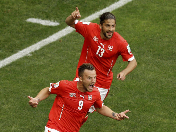 Switzerland's Haris Seferovic (9), front, celebrates with his teammate Ricardo Rodriguez after scoring his side's winning goal in the final minute