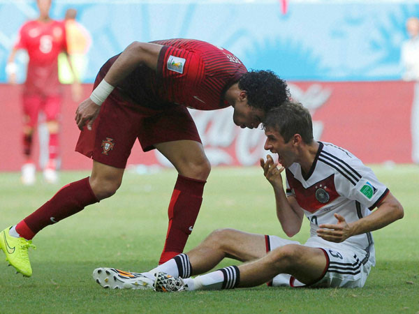 Portugal's Pepe, left, puts his head on Germany's Thomas Mueller