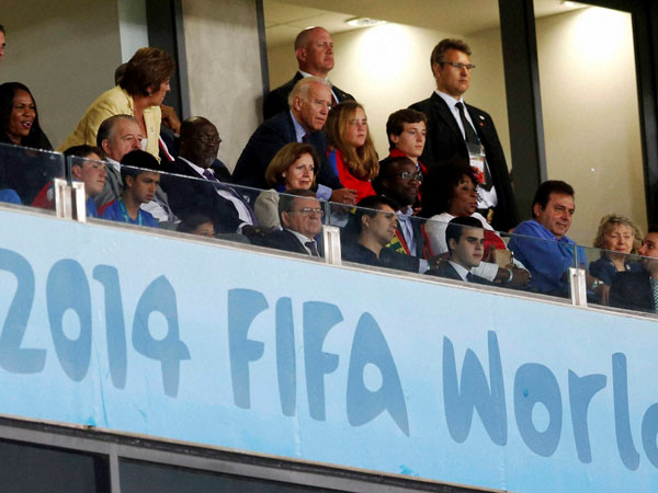 U.S. Vice President Joe Biden, center, watches the group G World Cup soccer match