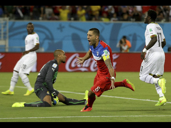 United States' Clint Dempsey turns away and celebrates after scoring the opening goal, in just 29 seconds