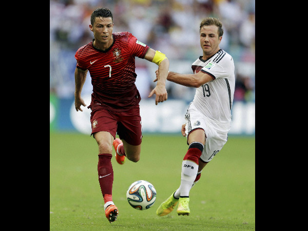 Portugal's Cristiano Ronaldo (7) races past Germany's Mario Goetze (19) during the group G World Cup match