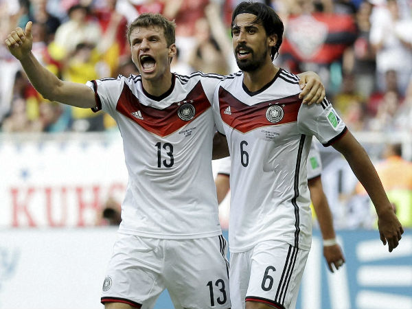 Thomas Muller (left) celebrates his goal at World Cup 2014