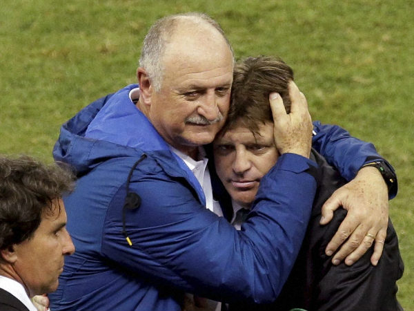 Brazil's coach Luiz Felipe Scolari, left, hugs Mexico's head coach Miguel Herrera after the Group A World Cup match