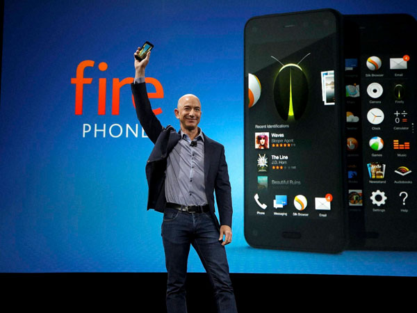 Amazon CEO Jeff Bezos holds up the new Amazon Fire Phone