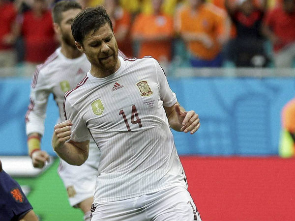 Xabi Alonso celebrates after scoring on penalty against Netherlands in their opening World Cup match