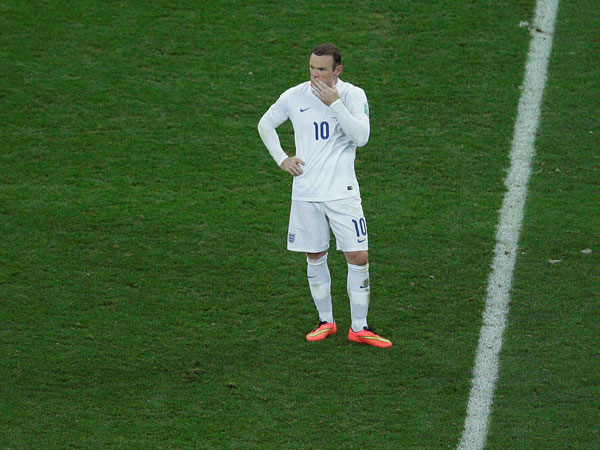 England's Wayne Rooney reacts during the group D World Cup soccer match