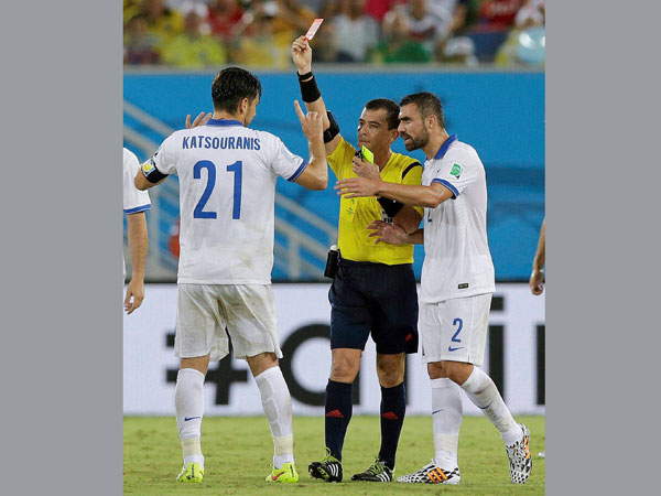 Referee Joel Aguilar from El Salvador shows a red card