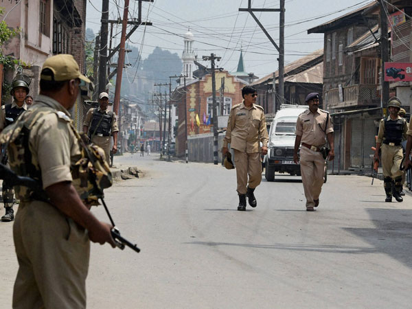 Security personnel petrolling a street in downtown Srinagar