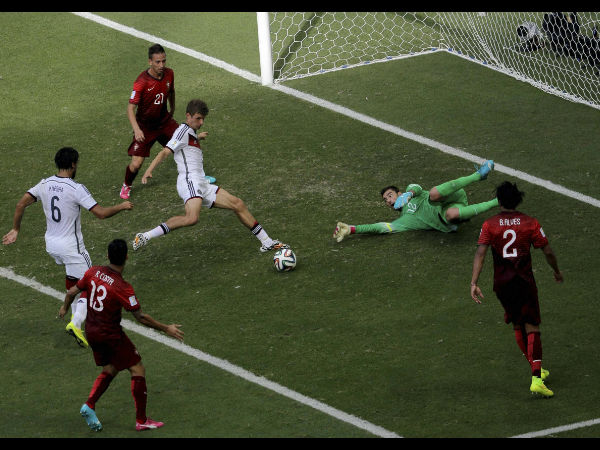 Germany's Thomas Muller scores a goal against Portugal