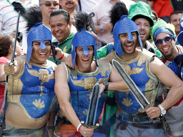 Italian supporters dressed as Roman Centurions react