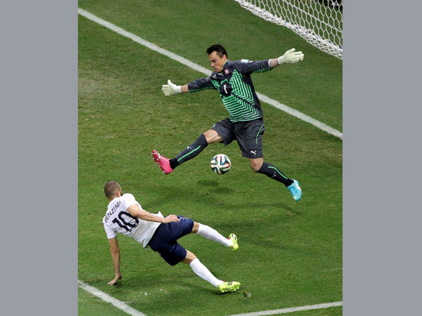 France's Karim Benzema, bottom, shoots and scores his side's fourth goal
