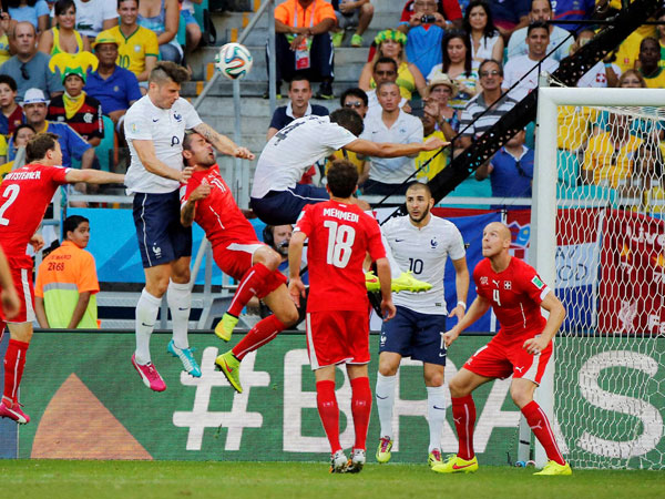 France's Olivier Giroud, second from left, scores the opening goal