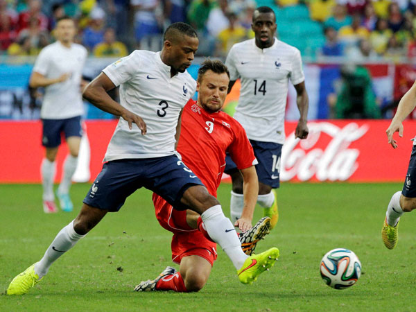 Switzerland's Haris Seferovic, right, challenges France's Patrice Evra