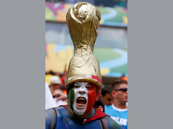 An Italian supporter reacts before the group D World Cup soccer