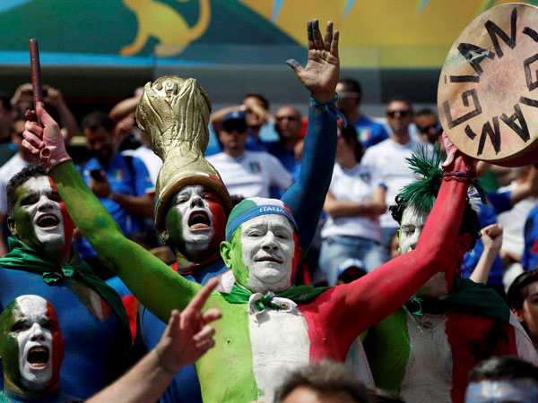 Italian supporters react before the group D World Cup soccer match