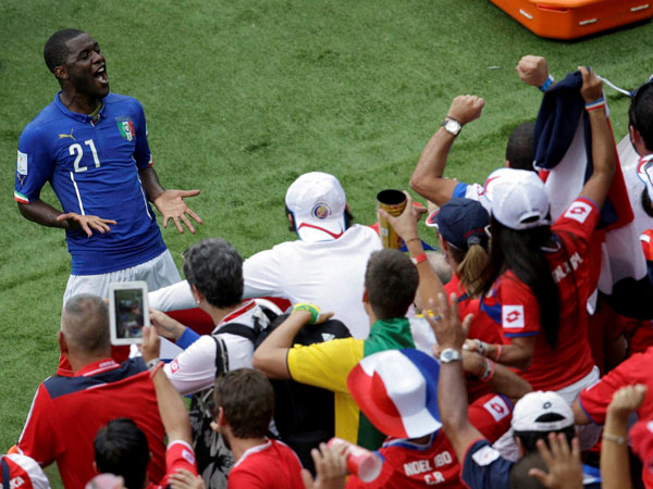 Costa Rica's Joel Campbell, left, celebrates with fans