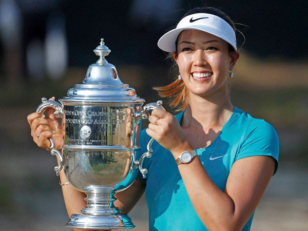 Wie poses with her trophy