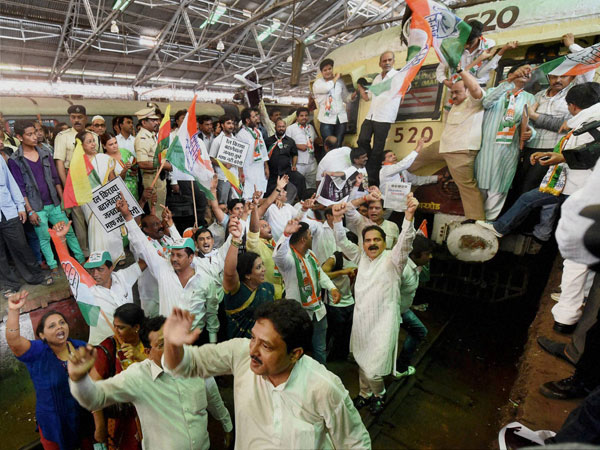 Congress workers stop an express train during a protest