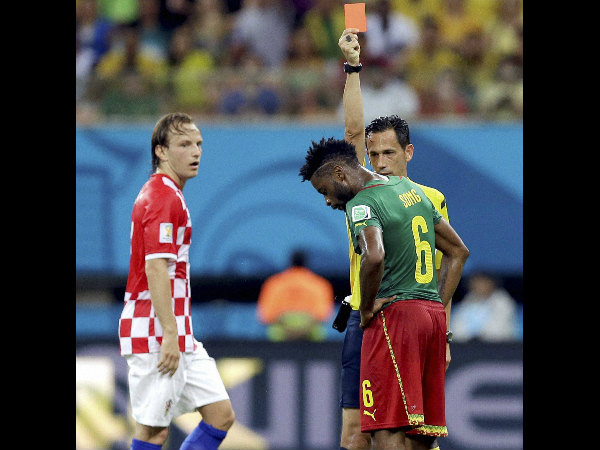 Referee Pedro Proenca from Portugal gives a red card to Cameroon's Alex Song as Croatia's Ivan Rakitic looks on during the group A World Cup soccer match between Cameroon and Croatia at the Arena da Amazonia in Manaus, Brazil, Wednesday, June 18.