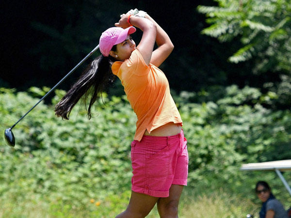 A woman player tees off during a golf event at Royal Spring Golf