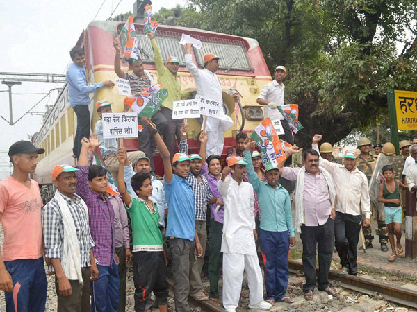 Trinamool Congress workers stop a train to protest