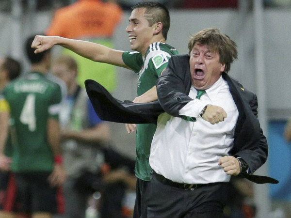 Mexico's coach Miguel Herrera celebrates after Andres Guardado scored his side's second goal during the Group A World Cup match against Croatia at the Arena Pernambuco in Recife, Brazil, Monday, June 23.