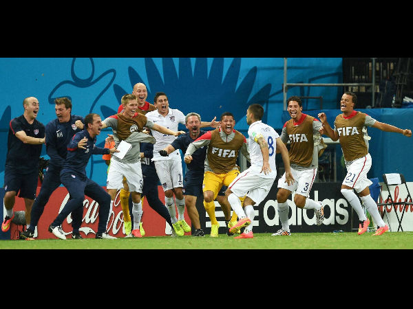 United States' Clint Dempsey (8) runs to celebrate with his teammates after scoring his side's second goal during the Group G World Cup match between the USA and Portugal at the Arena da Amazonia in Manaus, Brazil, Sunday, June 22.