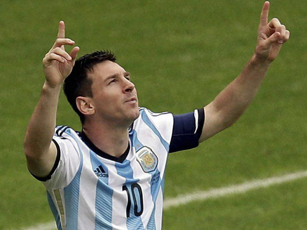Lionel Messi celebrates scoring his side's first goal during the Group F World Cup match against Nigeria and Argentina at the Estadio Beira-Rio in Porto Alegre on Wednesday (June 25).