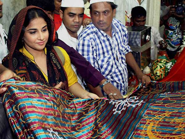 Bollywood actor Vidya Balan offering a chadar
