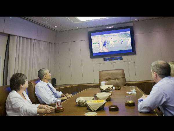 President Barack Obama, White House Senior Adviser Valerie Jarrett and White House Senior Adviser Dan Pfeiffer, right, watch the World Cup soccer match between US and Germany in the conference room aboard Air Force One en route to Minnesota, Thursday, June 26.