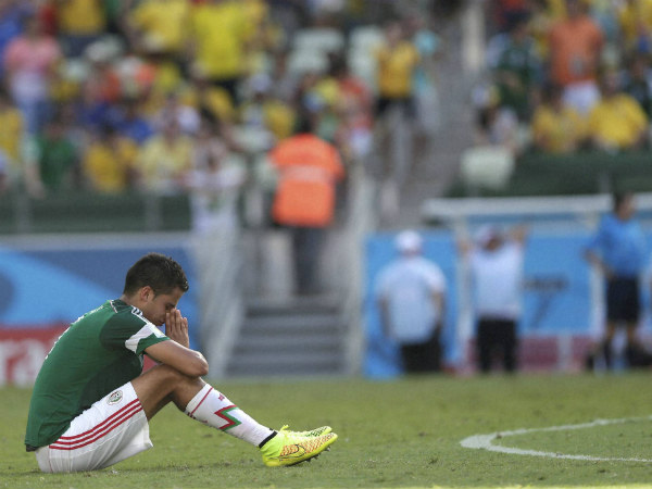 Mexico's Diego Reyes reacts after the loss to Netherlands