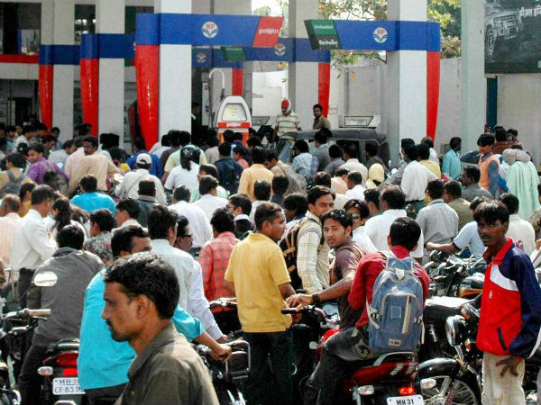 People line up to fill their vehicles at an oil pump in Nagpur after the announcement of hike in petrol prices on Monday. (PTI Photo)